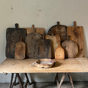 Collection of Antique Bread Boards with Creamer
