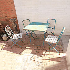 The metal garden or cafe set consists of 4 metal folding chairs